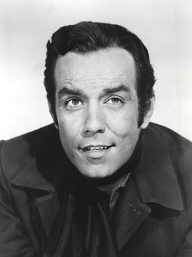 Bonanza Looking Up in Black Suit Portrait with White Background by Movie Star News