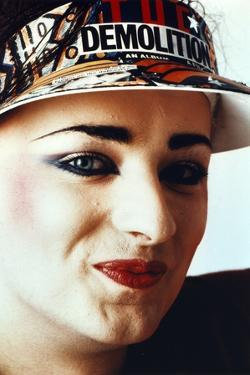 Boy George Woman's smiling wearing Sun Visor Cap Close Up Portrait by Movie Star News