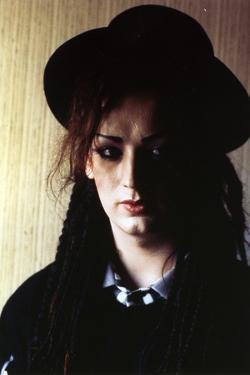Boy George Woman's wearing Black Dress and Black Hat Portrait by Movie Star News