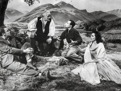 Brigadoon Excerpt Men and Woman sitting Under the Tree by Movie Star News