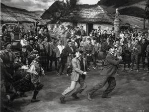 Brigadoon Excerpt Three Men Dancing in a Crowd by Movie Star News