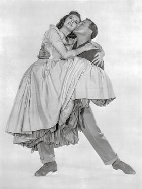 Brigadoon Man Carrying Lady in Gown by Movie Star News