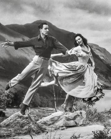 Brigadoon Woman and Man Jump Pose by Movie Star News