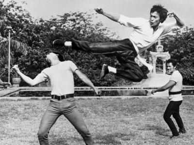Bruce Lee Floating and Kicking a Man by Movie Star News