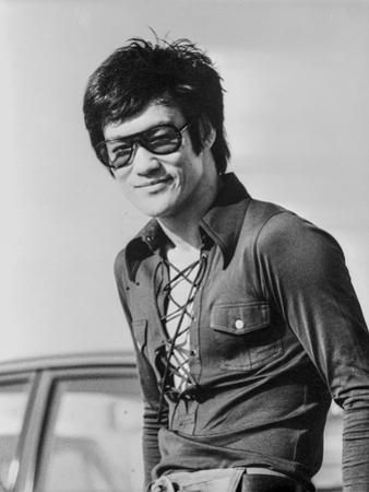 Bruce Lee posed in Classic Portrait by Movie Star News