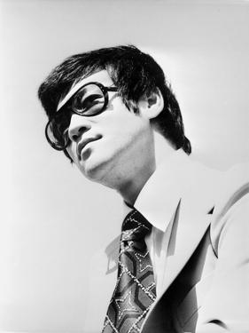 Bruce Lee Posed in Suit and Printed Necktie by Movie Star News