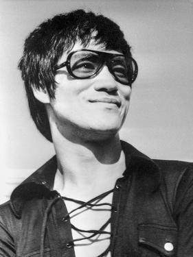 Bruce Lee wearing a Sun Glasses by Movie Star News