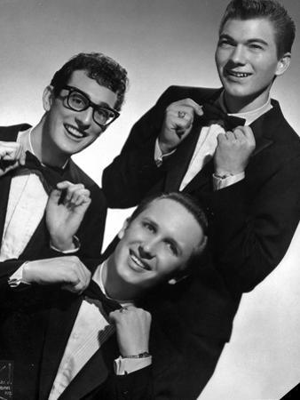 Buddy Holly Posed in Suit With White Background by Movie Star News