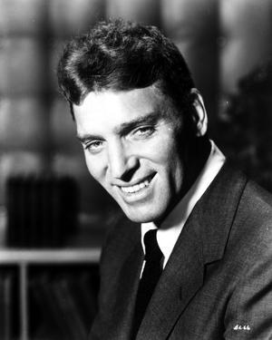 Burt Lancaster in Black Suit and smiling by Movie Star News