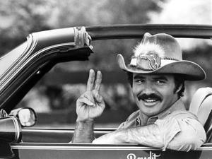Burt Reynolds Posed in Cowboy Attire With Peace Symbol by Movie Star News