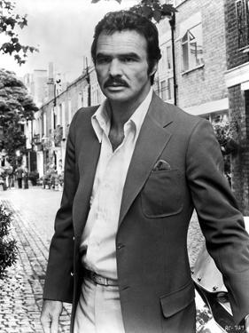 Burt Reynolds wearing a Black Suit by Movie Star News