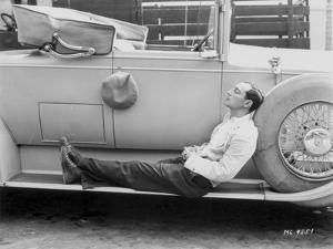 Buster Keaton posed on a Vintage Car in a Suit by Movie Star News