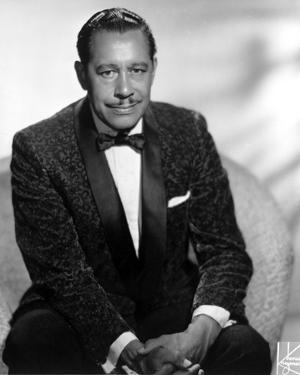 Cab Calloway sitting in Black Suit by Movie Star News