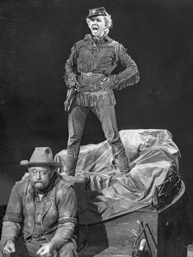 Calamity Jane standing Man and sitting Man in Black and White by Movie Star News