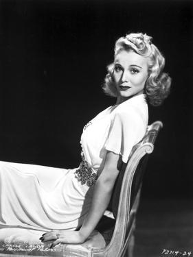 Carole Landis on a Dress sitting and posed by Movie Star News
