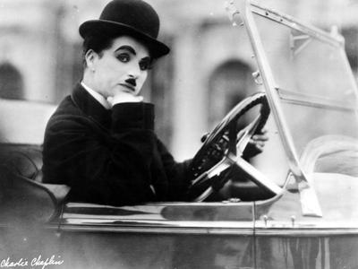 Charlie Chaplin Ridding in Vehicle