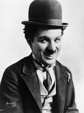 Charlie Chaplin smiling in a Coat and Tie by Movie Star News