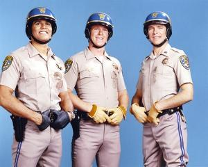 Chips Cast Posed Together in Police Uniform with Hands on Their Belt by Movie Star News
