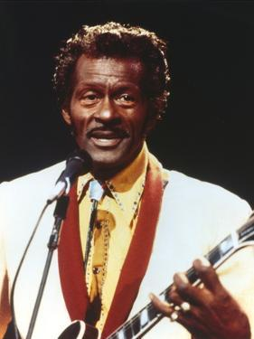 Chuck Berry Playing Guitar in White Tuxedo by Movie Star News