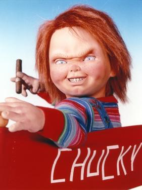 Chucky Holding Tabaco in Stripes Long Sleeve by Movie Star News