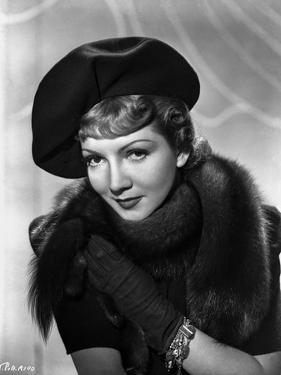Claudette Colbert Posed in Black Fur Dress with Hat by Movie Star News