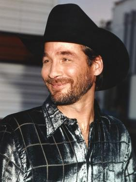 Clint Black smiling in Portrait by Movie Star News