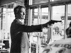 Clint Eastwood Pointing Pistol in Tuxedo by Movie Star News