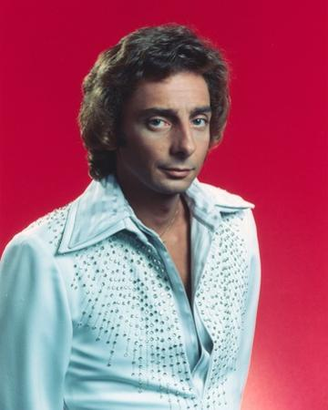 Close Up Portrait of Barry Manilow in White Sleeves with Red Background
