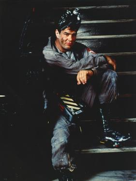 Dan Aykroyd Siting on Stairs in Classic Picture by Movie Star News