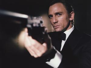 Daniel Craig Firing Pistol in Black Tuxedo by Movie Star News