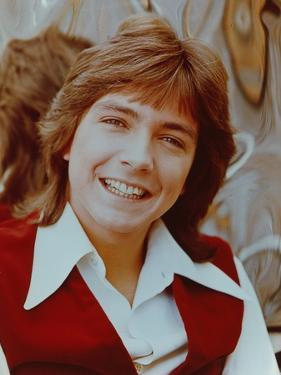 David Cassidy smiling in Red Vest by Movie Star News