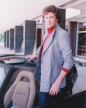 David Hasselhoff standing on a Car wearing Grey Coat by Movie Star News