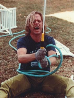 David Spade Holding a Water Hose by Movie Star News