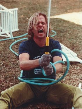 David Spade Holding a Water Hose by Movie Star News