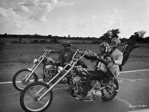 Easy Rider Riding Big Bike in Classic with Helmet by Movie Star News