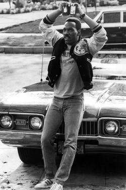Eddie Murphy standing in Varsity Jacket by Movie Star News