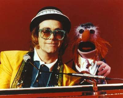 Elton John Playing Piano in Yellow Suit