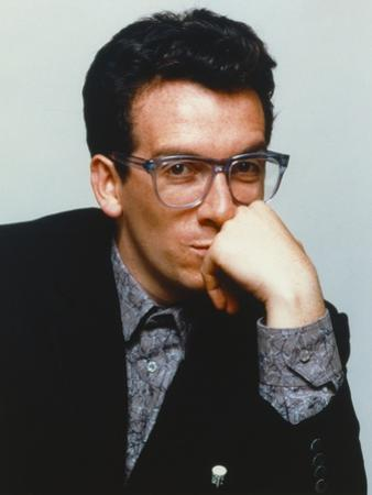 Elvis Costello Leaning Chin On Hand in Black Tuxedo