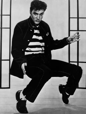 Elvis Presley Bending in Stripes Shirt by Movie Star News