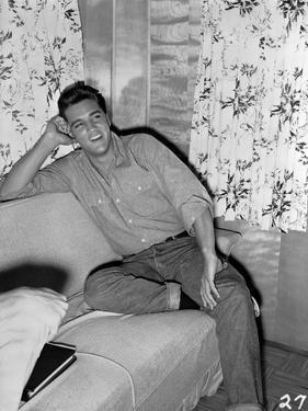 Elvis Presley Leaning on Bed Black and White by Movie Star News