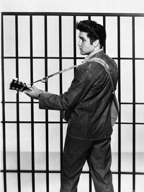 Elvis Presley Looking Back and Playing Guitar in Classic by Movie Star News