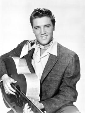 Elvis Presley Seated in Classic with Scarf by Movie Star News