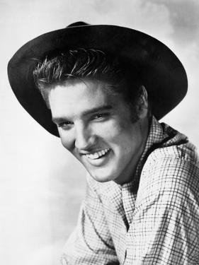 Elvis Presley smiling in Plaid Polo by Movie Star News