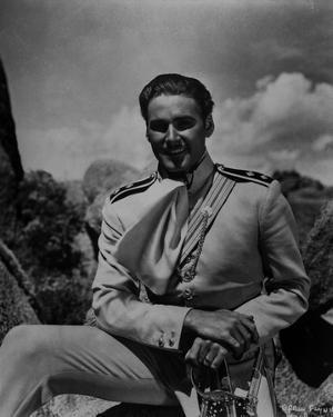 Errol Flynn smiling in Classic by Movie Star News