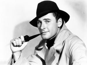 Errol Flynn wearing a Felt Hat with a smiling Portrait by Movie Star News