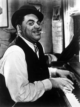 Fats Waller Smoking Cigarette while Playing the Piano by Movie Star News