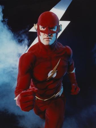 Flash Running Pose with Flash Icon in Background by Movie Star News