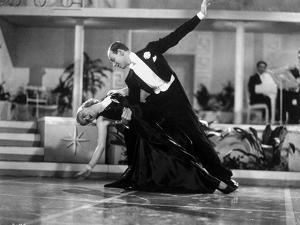 Fred Astaire and Ginger Rogers Dancing in Black Dress and Black Tuxedo with Audience Watching by Movie Star News