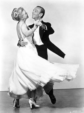 Fred Astaire and Ginger Rogers Dancing in White Dress and Black Suit by Movie Star News