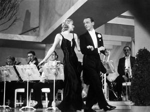Fred Astaire and Ginger Rogers Walking in Front of Orchestra by Movie Star News
